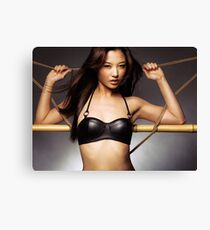 Sexy asian woman in black leather bra leaning against ropes art photo print Canvas Print