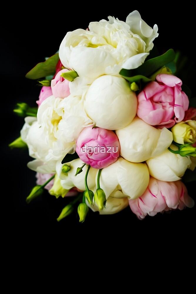 Wedding bouquet of ranunculus and peony flowers on black  by dariazu