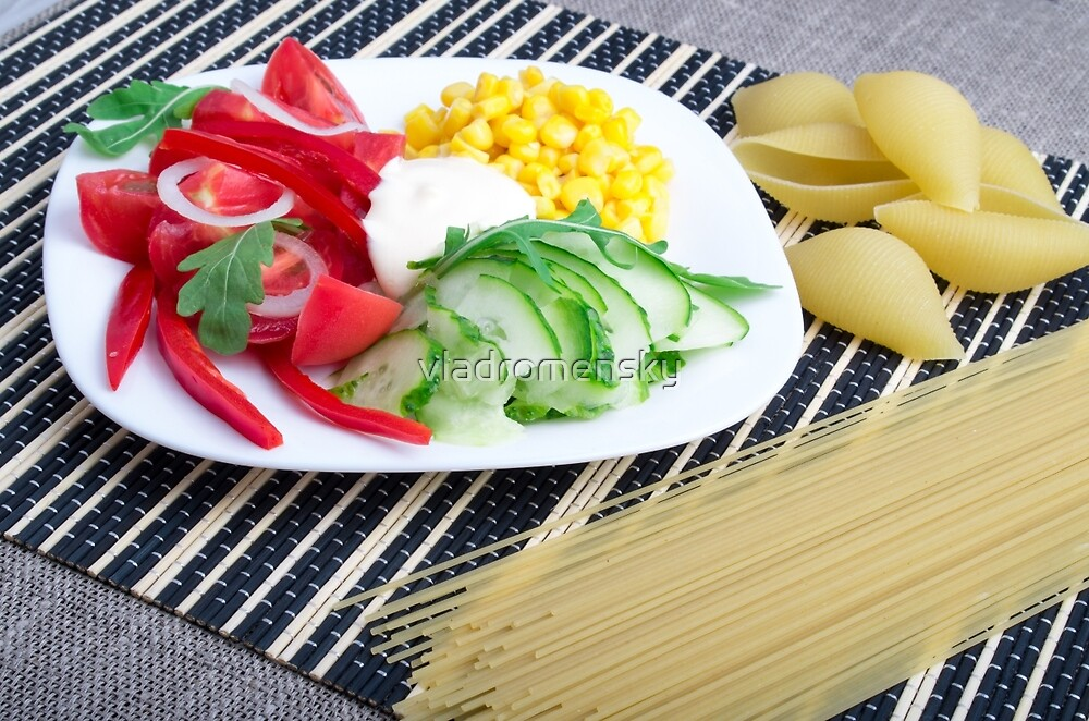 Closeup view of a vegetarian dish of raw vegetables by vladromensky