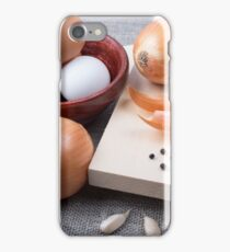 Table with raw ingredients for the preparation of natural food iPhone Case/Skin
