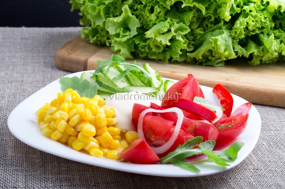 Natural salad of tomatoes, mozarella cheese, cucumbers, corn, lettuce and ruccola by vladromensky