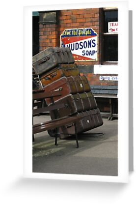 Vintage leather luggage at the Rail Station with soap signs. by Tom Conway