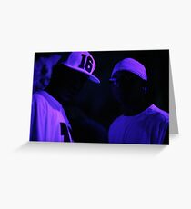Hip hop rap gangster rappers singers at night in dark nightclub bar lit in pink black light wearing baseball caps Greeting Card