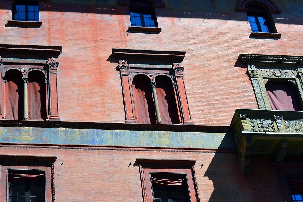 Building facade from Bologna with red brick and classical decoration by oanaunciuleanu