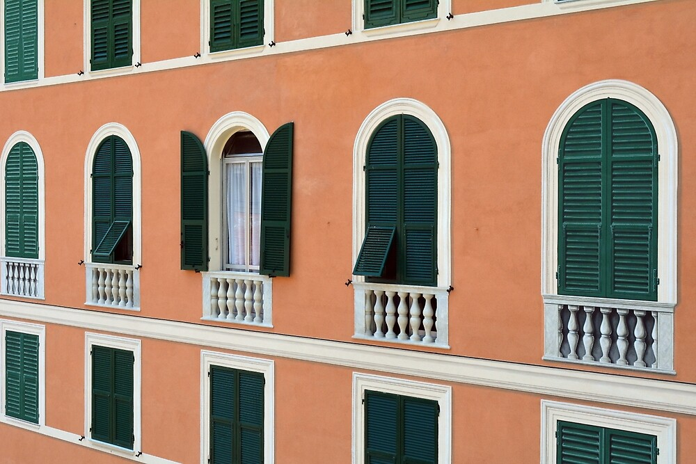Orange Italian facade with arched windows by oanaunciuleanu
