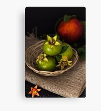 Green pomegranate in basket  Canvas Print
