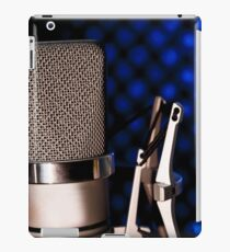Silver microphone on black and blue background iPad Case/Skin