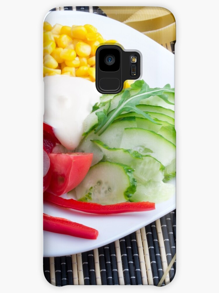 Slices of fresh raw vegetables on a striped background by vladromensky