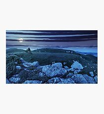 trees on hillside among huge boulders at night Photographic Print