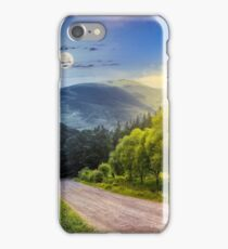 fence near road down the hill with  forest in mountains day and night iPhone Case/Skin
