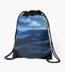 flowers on hillside meadow in mountain at night Drawstring Bag