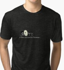 Incognita had received one inappropriate present after another... Tri-blend T-Shirt