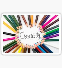 Colouring pencils in circle arrangement with message Creativity Sticker
