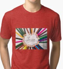 Colouring pencils in circle arrangement with message Learn Tri-blend T-Shirt