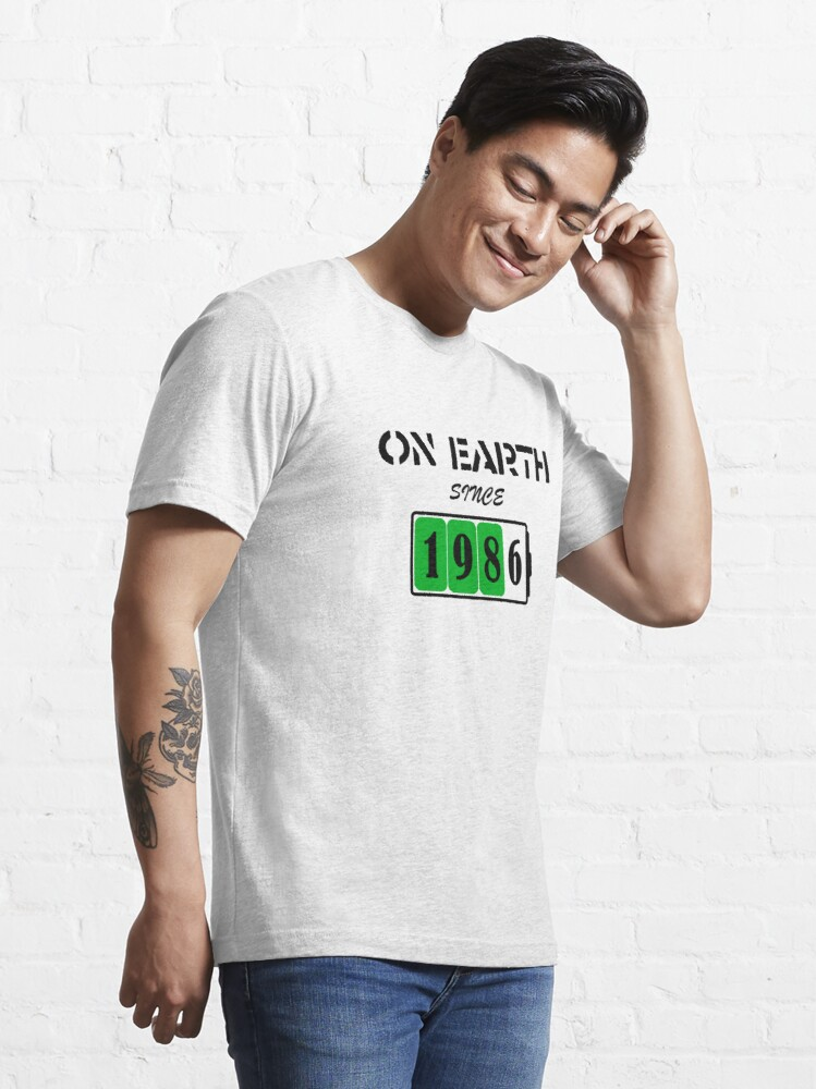 Alternate view of On Earth Since 1986 Essential T-Shirt
