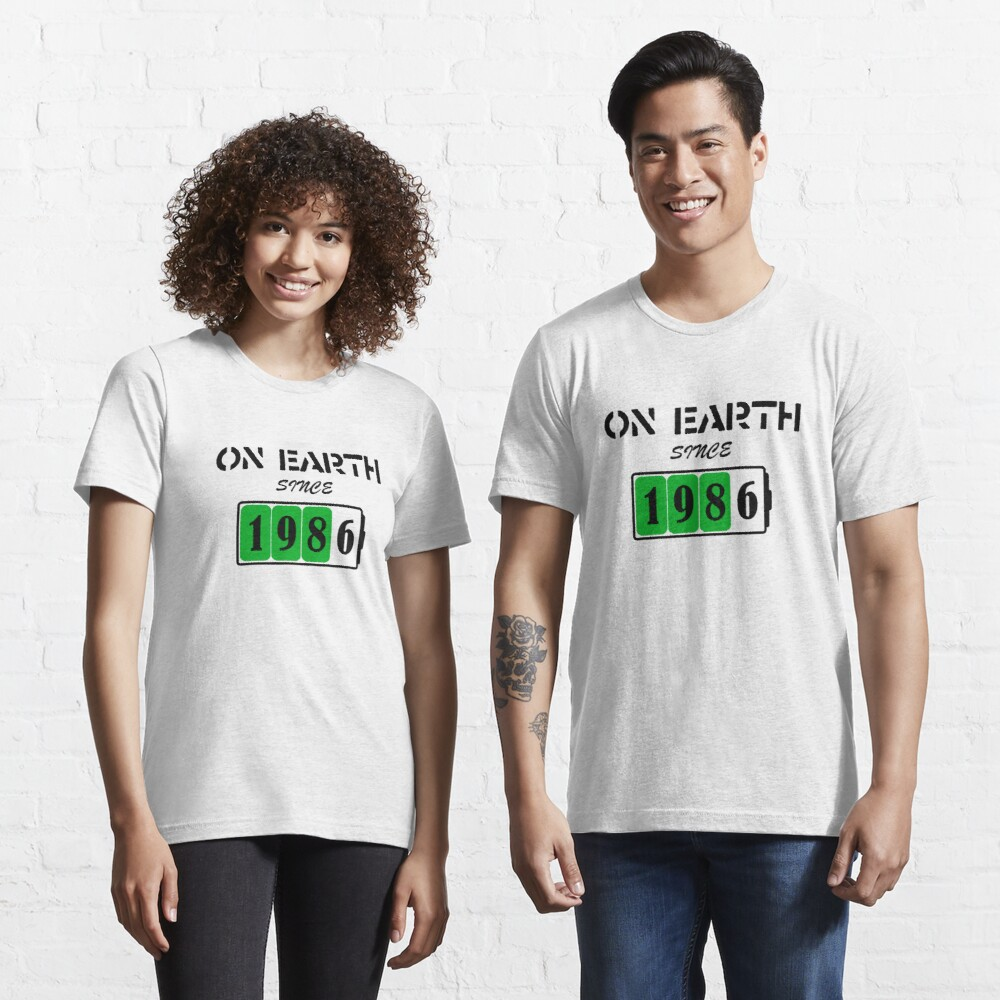 On Earth Since 1986 Essential T-Shirt