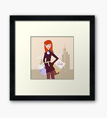 Fashion woman with shopping bags in town Framed Print
