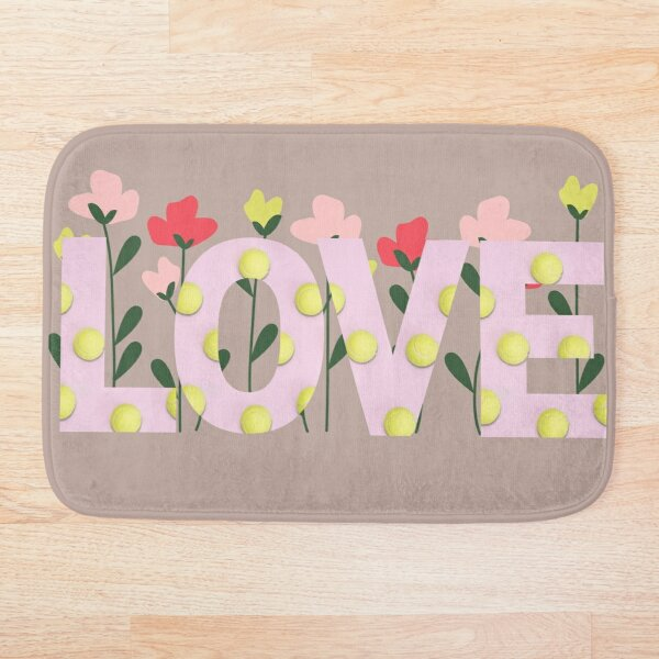 Pink Love Tennis Ball Print Wording with Flowers in the Background Bath Mat