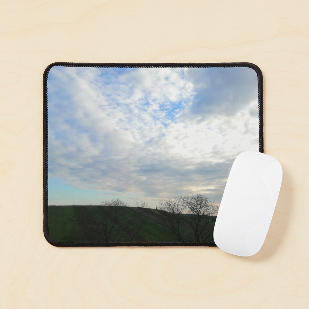 Mountain landscape at sunset, a few fluffy clouds and scattered skies in the sky, wonderful shades of colors Mouse Pad