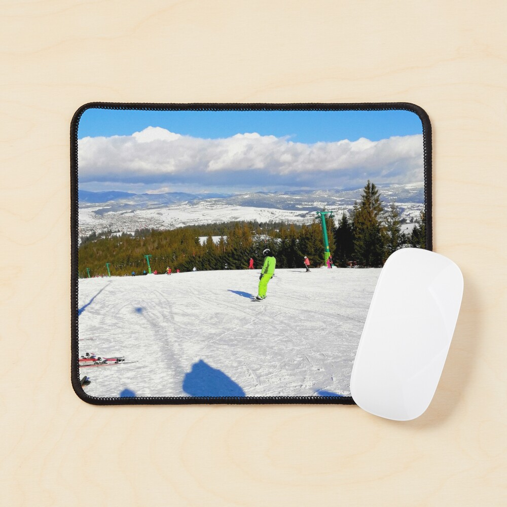 Landscape on the ski slope, sunny day, people feeling good, mountains in the distance, beautiful clouds in the sky Mouse Pad