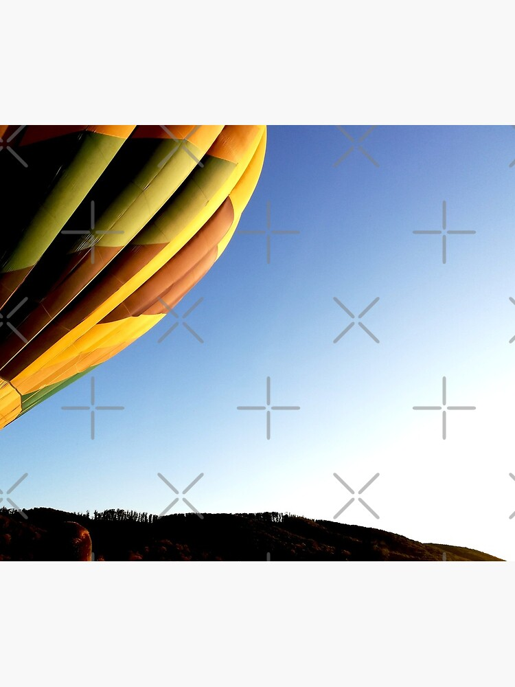 Colorful hot air balloon rising, sky without clouds, wonderful landscape by CWartDesign