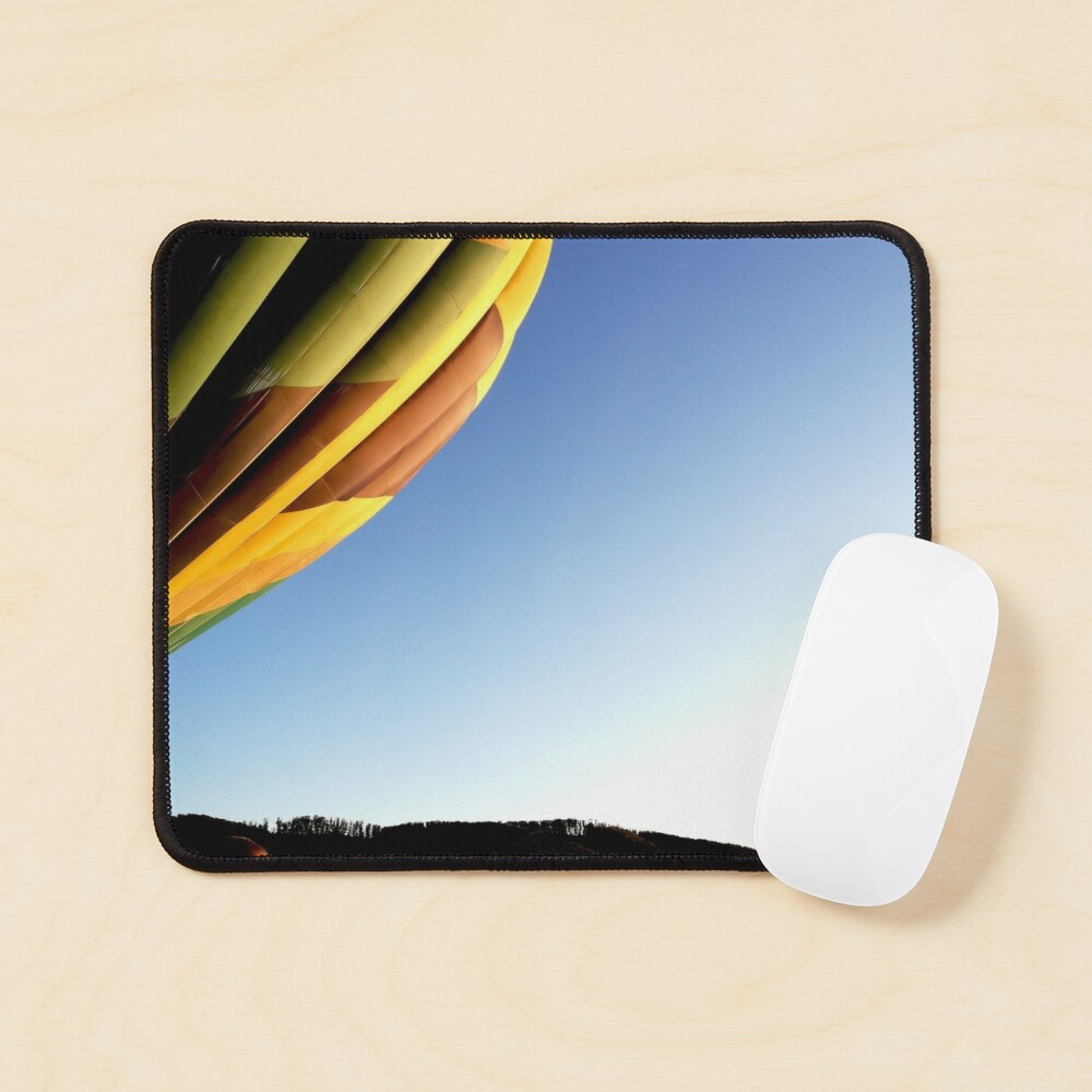 Colorful hot air balloon rising, sky without clouds, wonderful landscape Mouse Pad