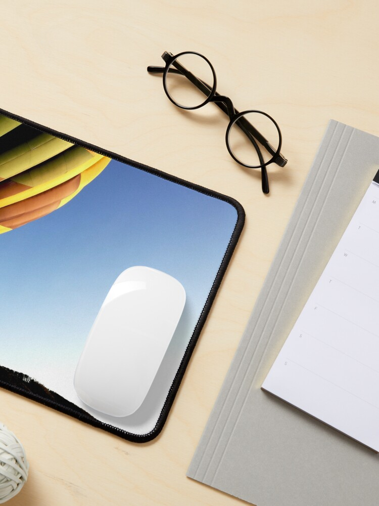 Alternate view of Colorful hot air balloon rising, sky without clouds, wonderful landscape Mouse Pad