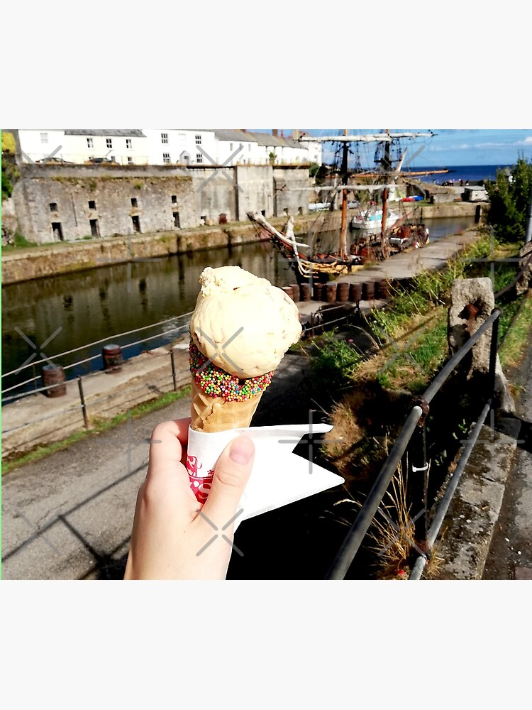 Person holding an ice cream cone near a sailboat and an old building, sunny day with clouds in the sky by CWartDesign