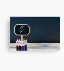 Wooden mini blackboard label with light bulb as idea  Canvas Print