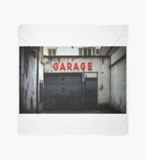 Old abandoned garage with red sign in historical center of Strasbourg Scarf