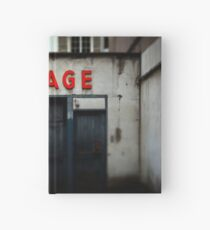 Old abandoned garage with red sign in historical center of Strasbourg Hardcover Journal