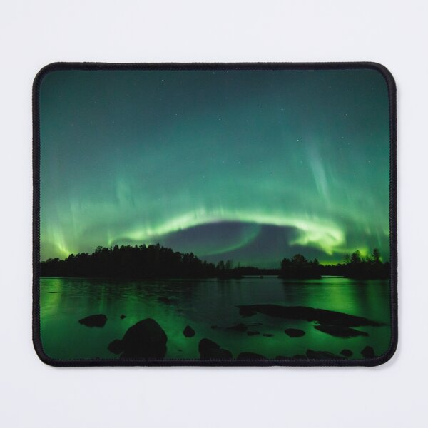 Beautiful northern lights over lake Mouse Pad
