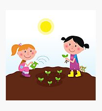 Two happy kids watering and planting plants in the garden Photographic Print