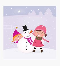 Happy smiling kids in winter costumes making snowman Photographic Print