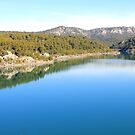 Mountain landscape with blue river, in Provence, France by gianliguori