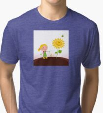 Spring gardening : Gardener child with sunflower in the garden Tri-blend T-Shirt