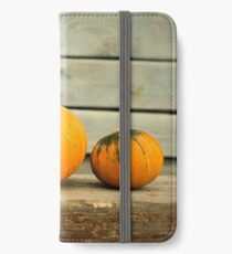 Pumpkins on a wooden background iPhone Wallet/Case/Skin
