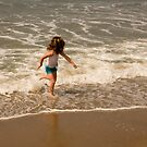 Red Haired Girl Running on the Beach by Buckwhite