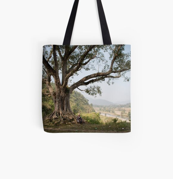 Nepali man sitting under a tree All Over Print Tote Bag