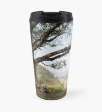 Nepali man sitting under a tree Travel Mug