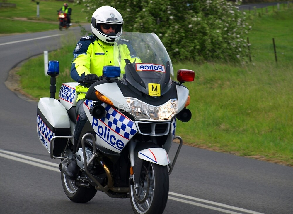 Police motorcyclist with Herald-Sun Bike Ride  by Bev Pascoe