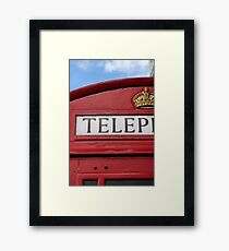 red phone booth Framed Print