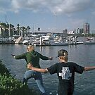 Two peas in a pod - skipping in the rocks in Long Beach, CA (Check out the brothers' shirt) by leih2008