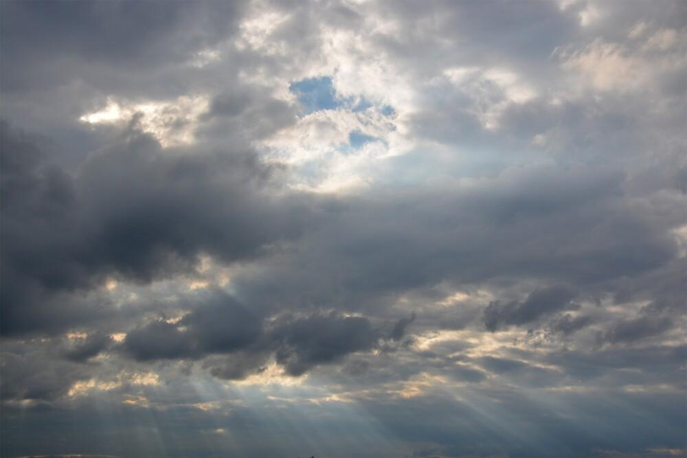 Sun and rain in the sky by Arie Koene