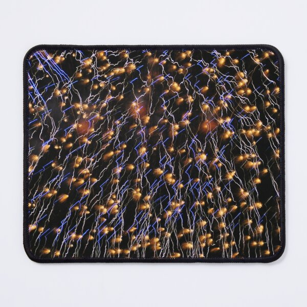 Closeup of an exploding firework filling the night sky. Mouse Pad