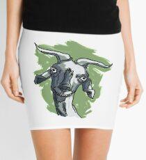 La cabra Asunción con Fondo Minifalda