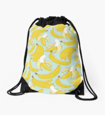 Banana pattern on turquoise background Drawstring Bag