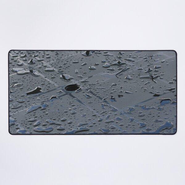 Globules of rain sit up on top of plastic table Desk Mat