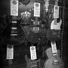 Electric Guitars in Window Display by Ed Sweetman