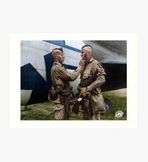 Filthy Thirteen member Clarence Ware applies war paint to Charles Plaudo. England, 31 December 1943. Art Print